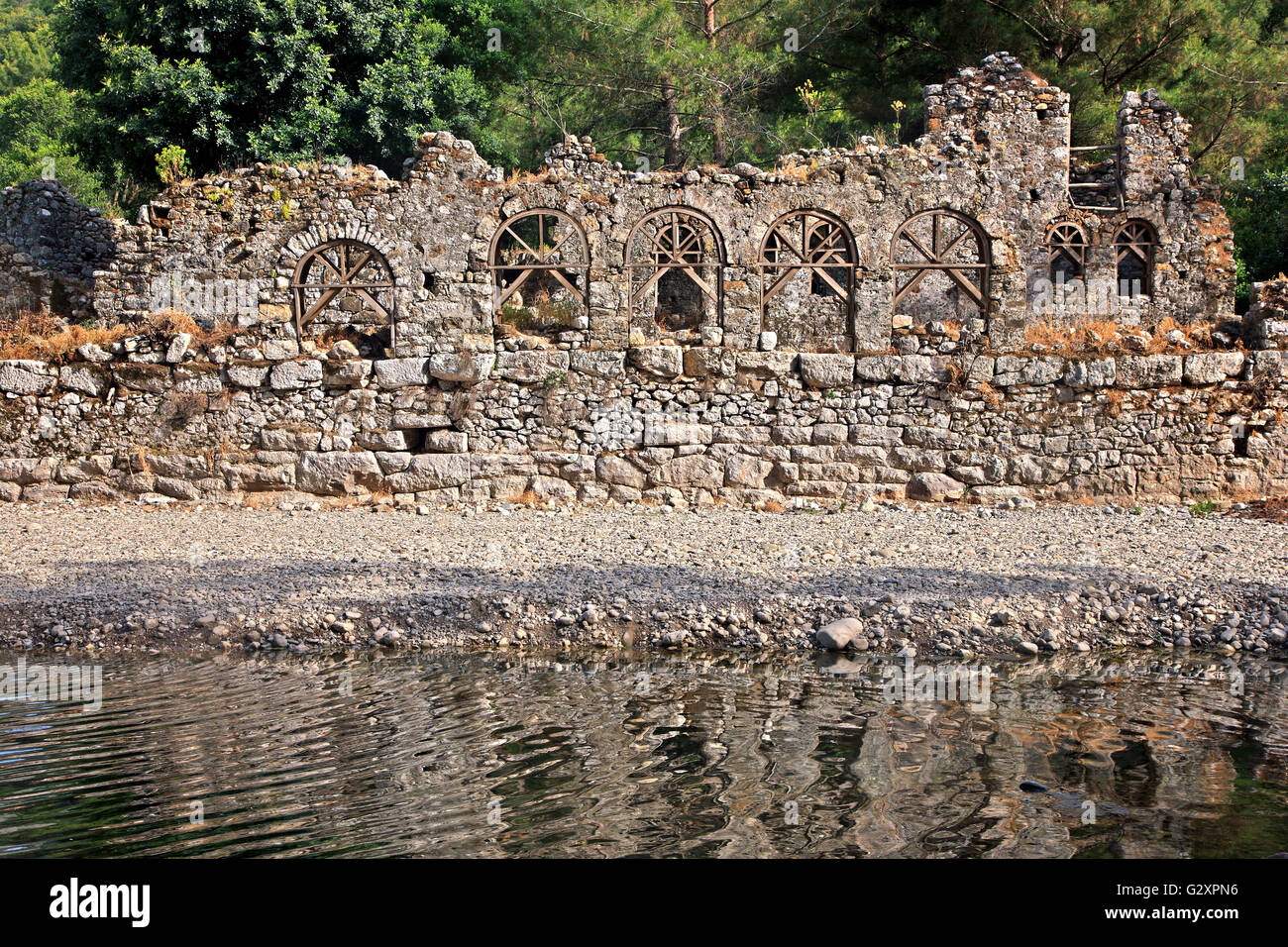 Ruins of ancient public baths at the archaeological site of Olympos, Lycia, Antalya province, Turkey. - Stock Image