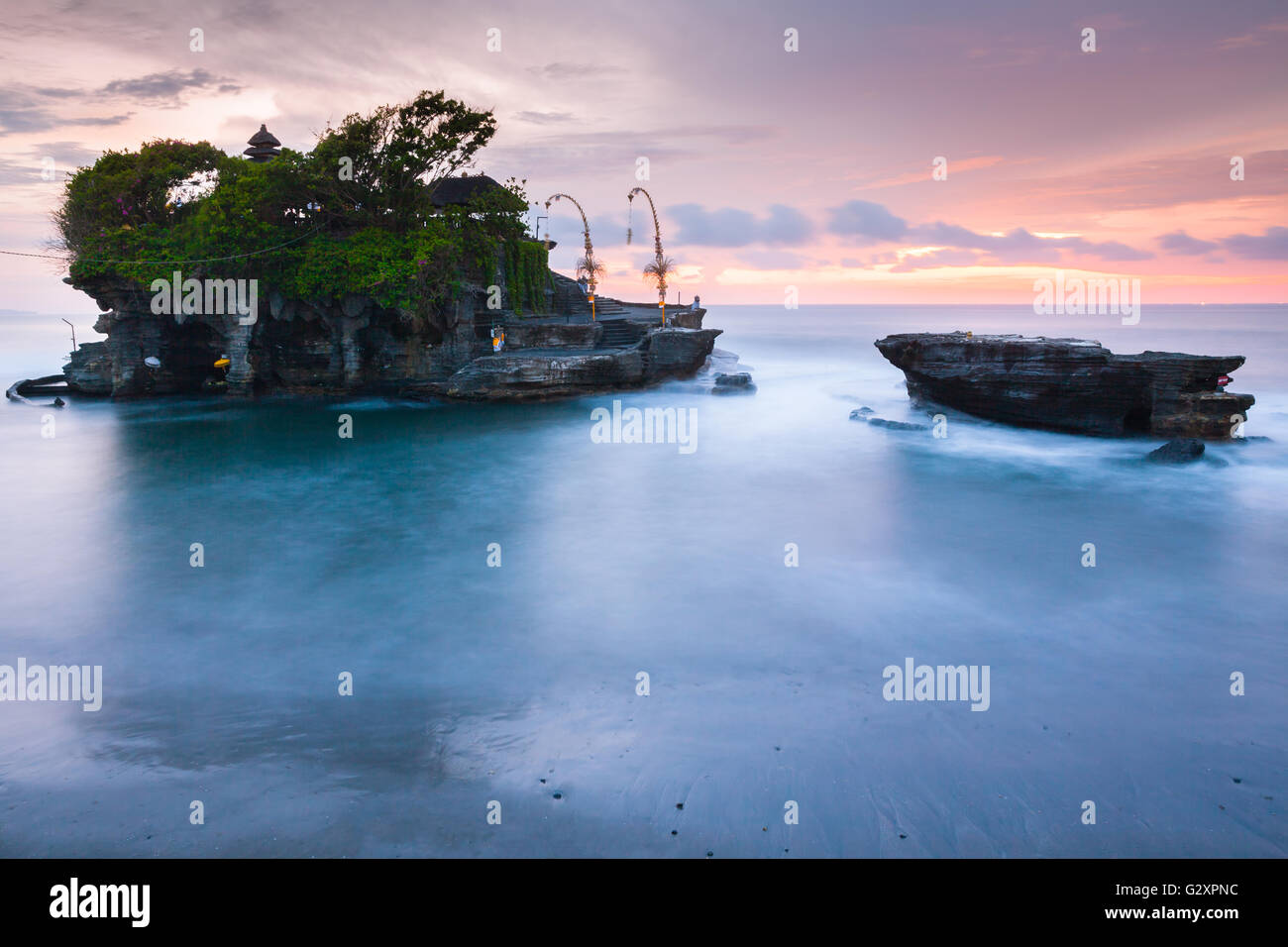 Pura Tanah Lot at sunset, famous ocean temple in Bali, Indonesia. - Stock Image