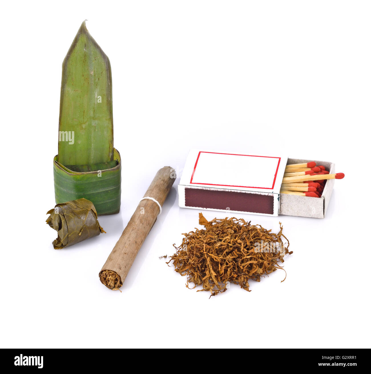 Tobacco , cigarette and food wrapped in leaves on white background - Stock Image
