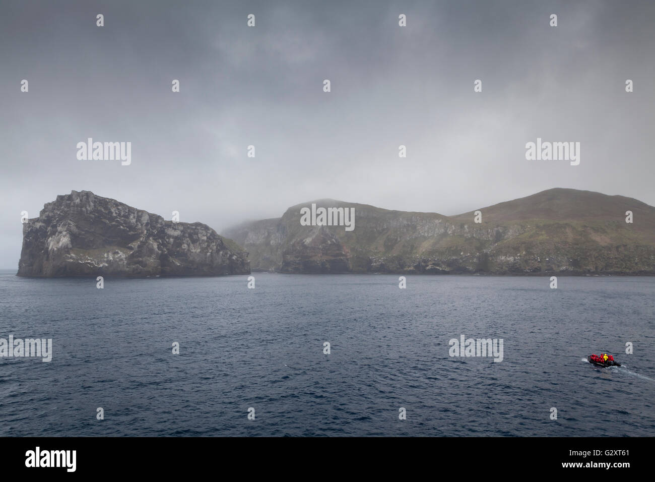 Zodiac cruising at Antipodes Island, New Zealand sub-Antarctic Stock Photo