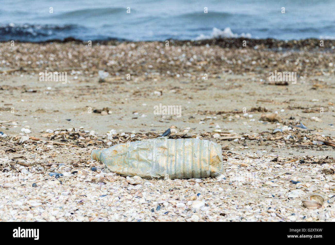 plastic bottle on the beach - Stock Image