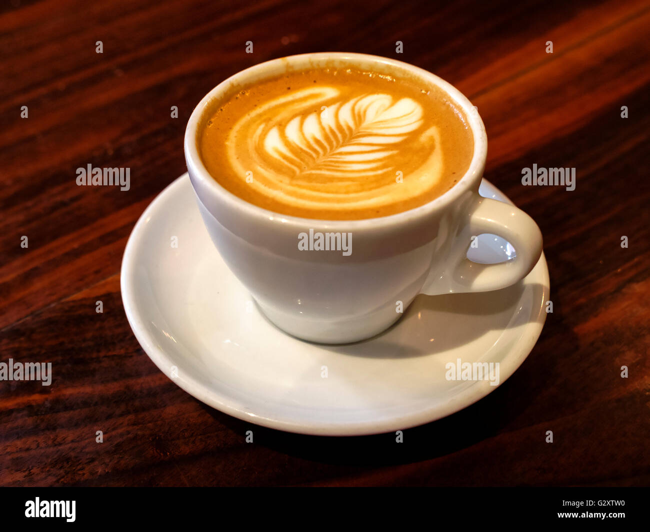 Cappuccino in a white cup and saucer - Stock Image
