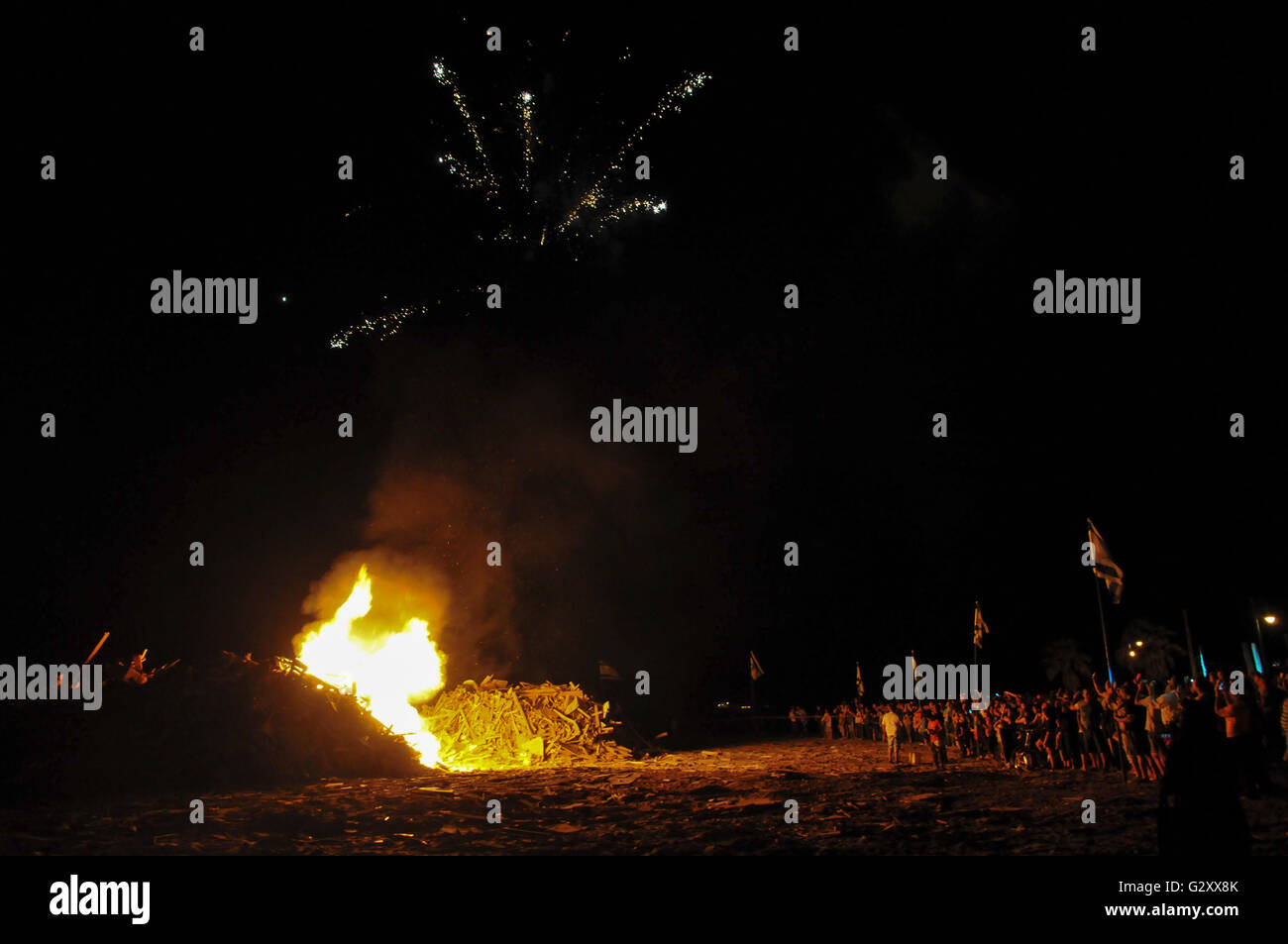 Celebrating the Jewish holiday of Lag Baomer with a bonfire and fireworks - Stock Image