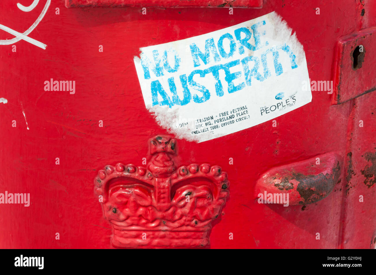 No More Austerity sticker on a red pillar box. - Stock Image
