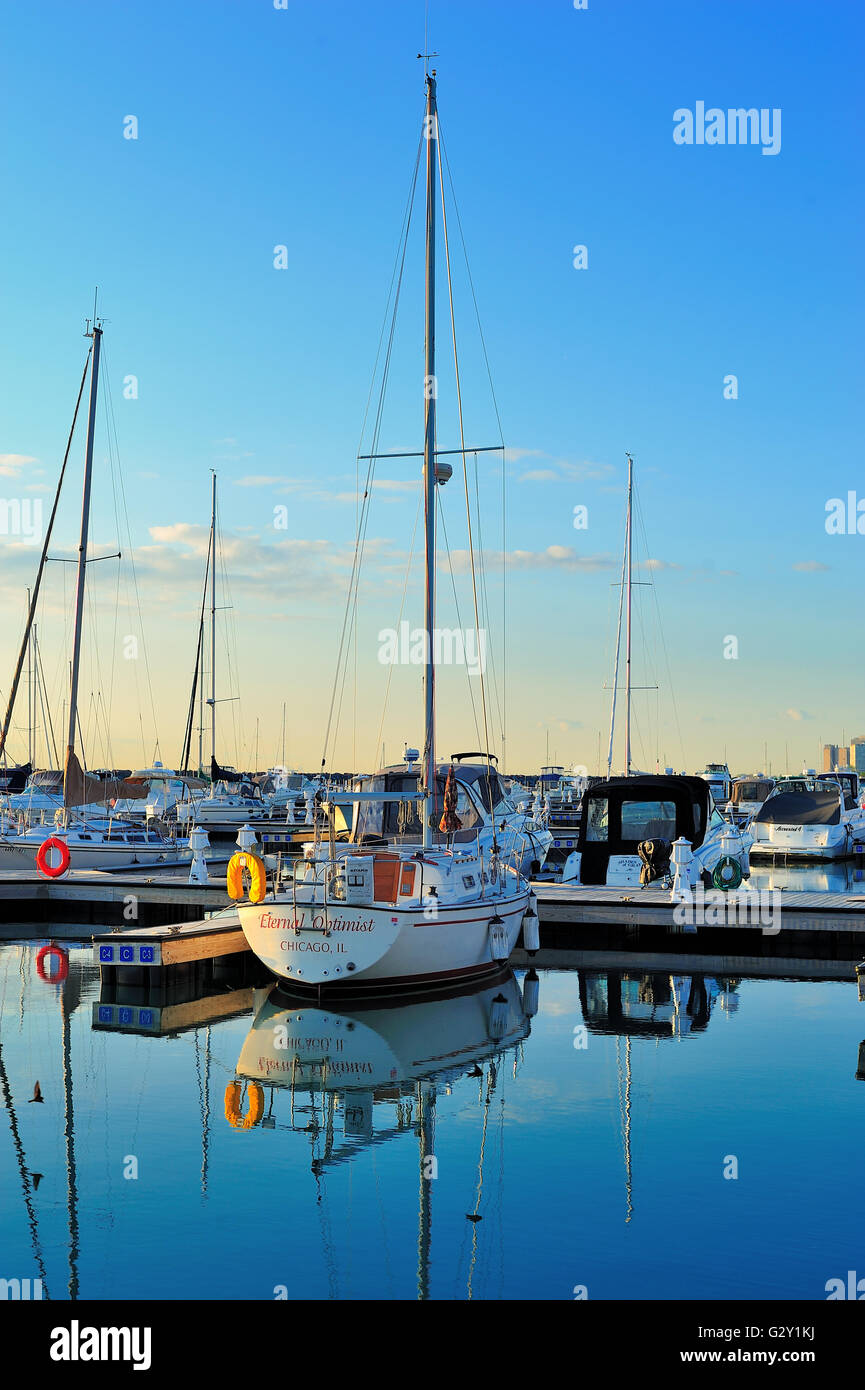 Chicago, Illinois, USA.Calm water in Chicago's 31st Street Harbor provides reflections of sailboats and other - Stock Image