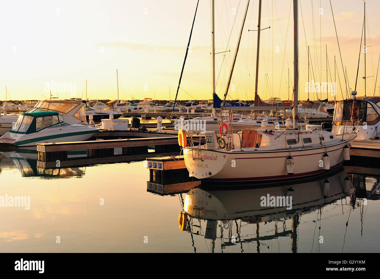 Chicago, Illinois, USA.Shortly after a colorful sunrise, calm water in Chicago's 31st Street Harbor provides - Stock Image