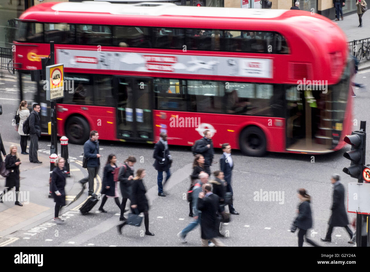 Bus and pedestrians at a busy London junction - Stock Image