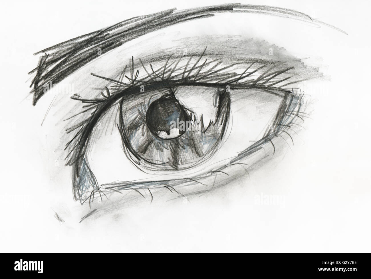 Childs drawing black and white picture of human eye close up hand drawing by pencil