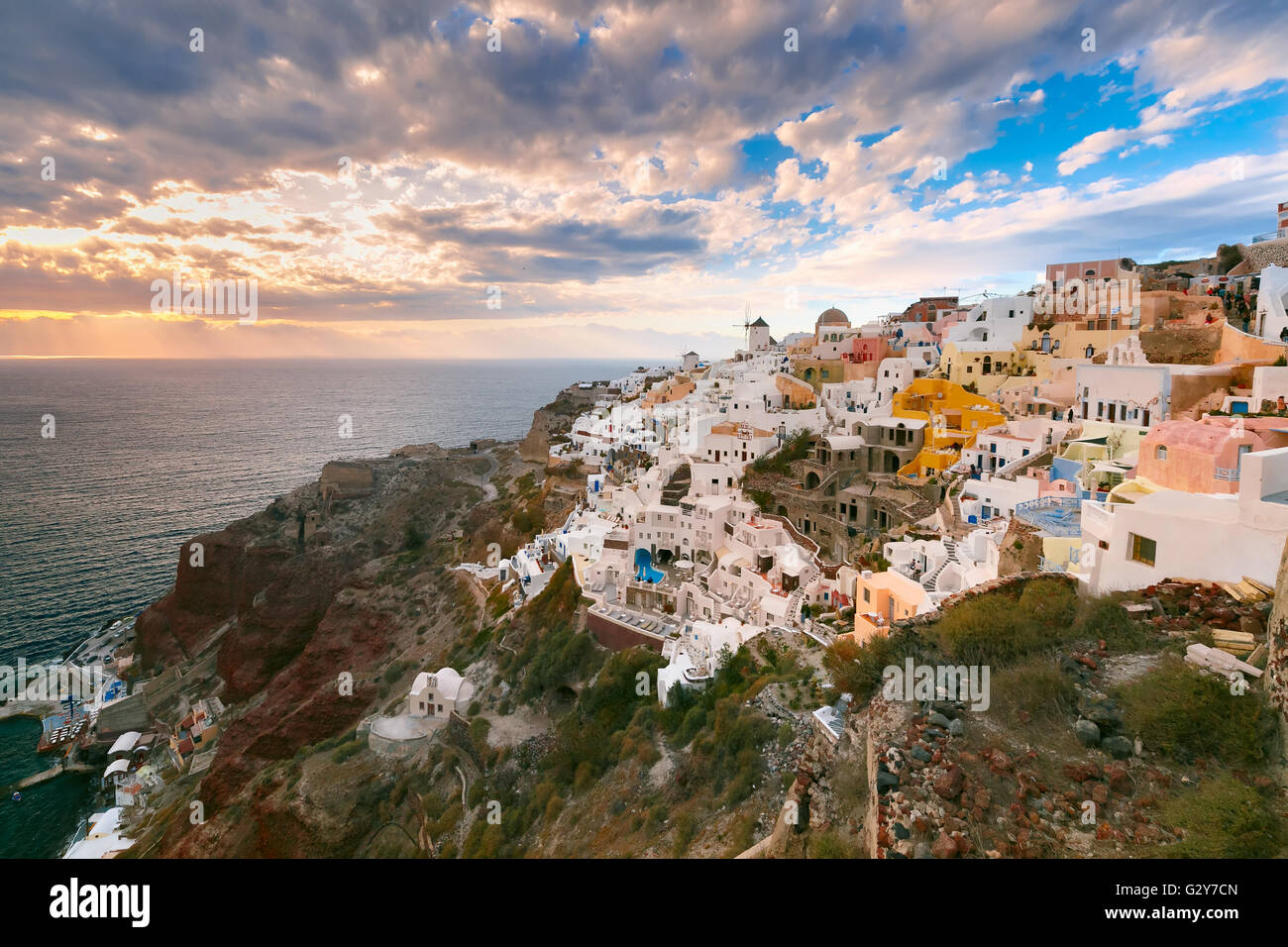 Oia or Ia at sunset, Santorini, Greece - Stock Image