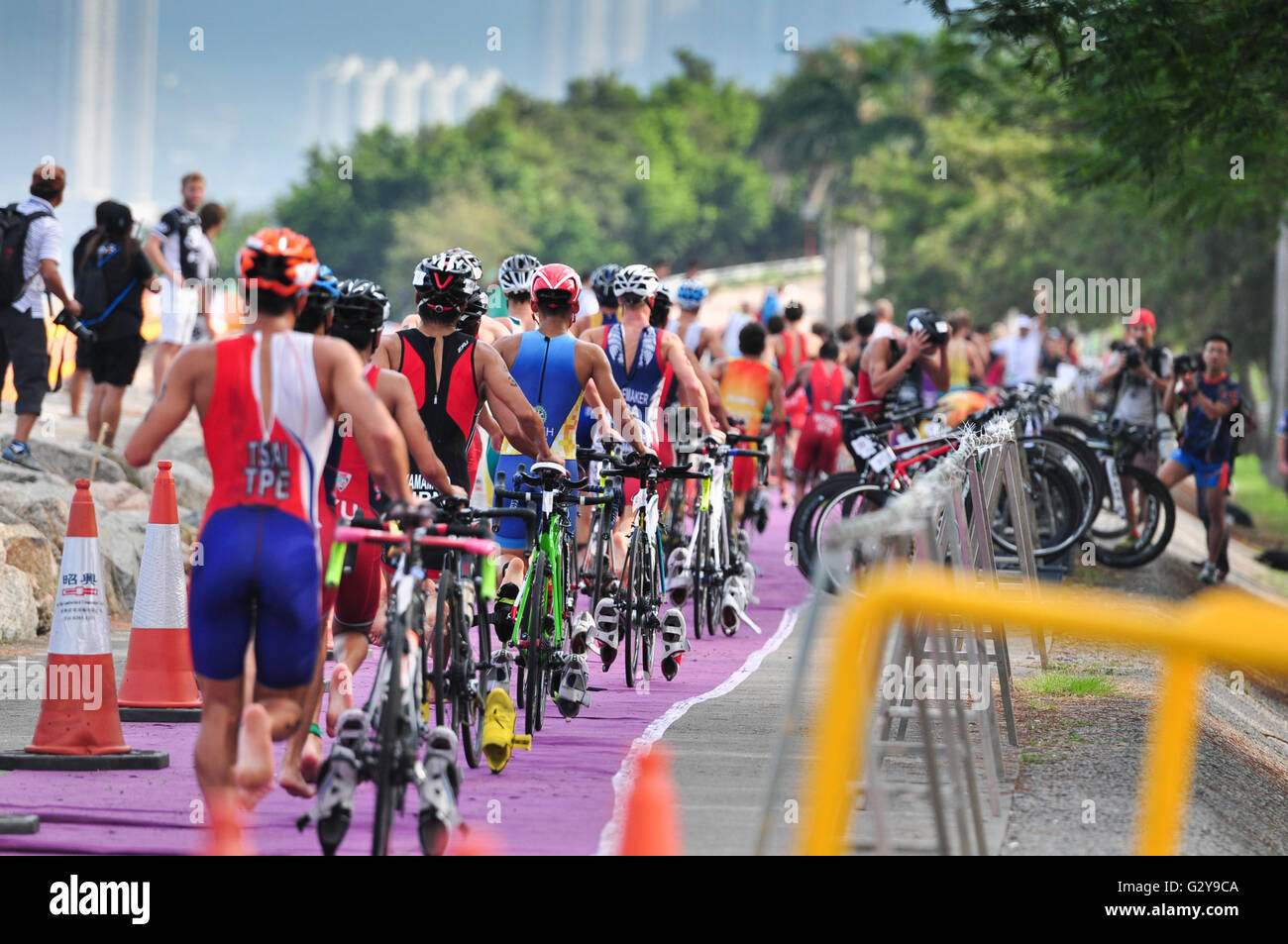 Male eltite triathletes at the transition during the Hong Kong Life ASTC Sprint Triathlon Asian Cup 2015 - Stock Image
