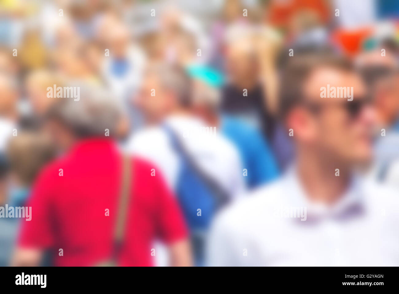 Crowded street as blur background, unrecognizable everyday ordinary people commuting - Stock Image