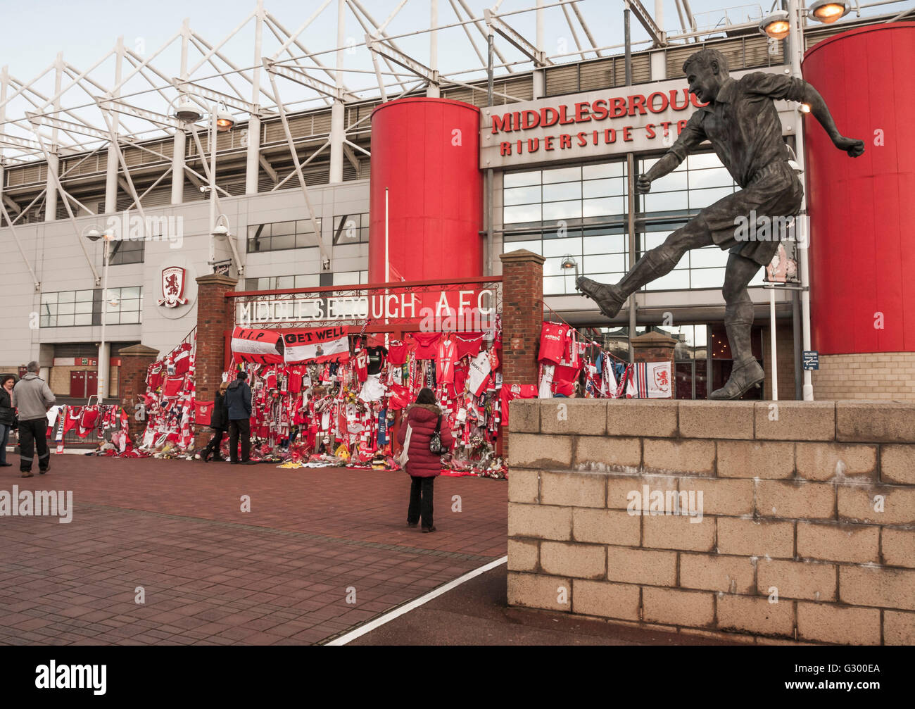 Fans look at the tributes at Middlesbrough football stadium to Alastair Brownlee,football commentator,who died in - Stock Image