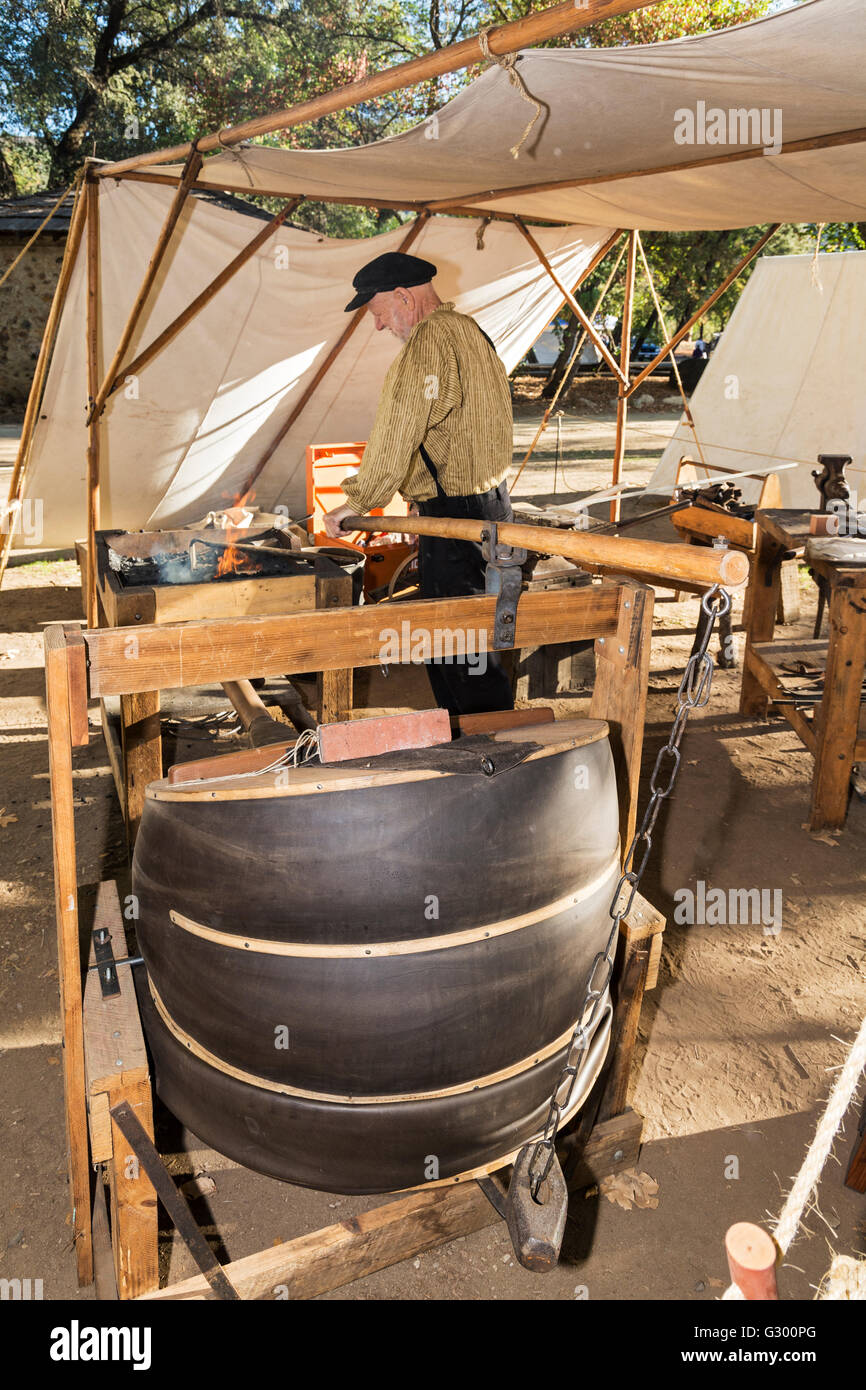California, Coloma, Marshall Gold Discovery State Historic Park, 'Gold Rush Live' , blacksmith reenactor - Stock Image