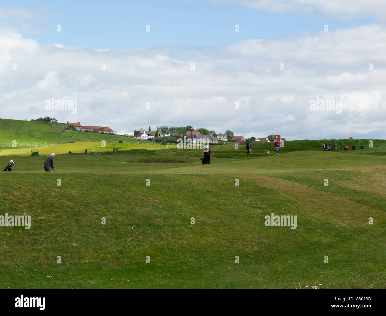Golfers making most lovely weather Earlsferry golf Course Fife Scotland magnificent 18-hole course largely unchanged - Stock Image