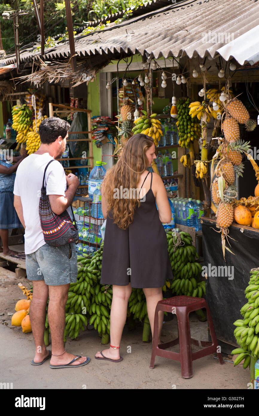 Sri Lanka, Ella, tourists shopping in fruit and vegetable market Stock Photo