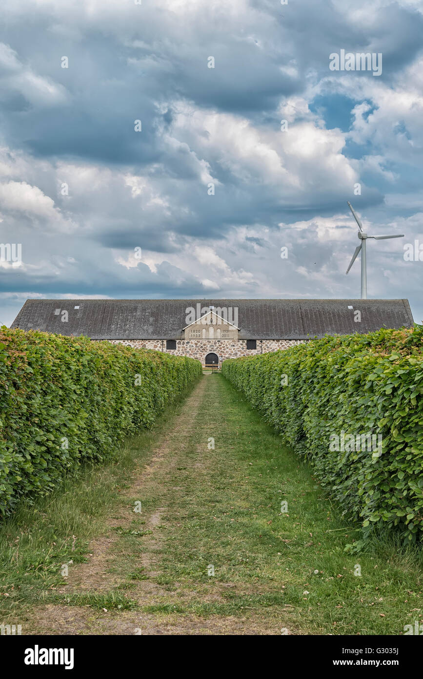 An old stone barn and stables set in the rural countryside of Swedens Halland region. - Stock Image