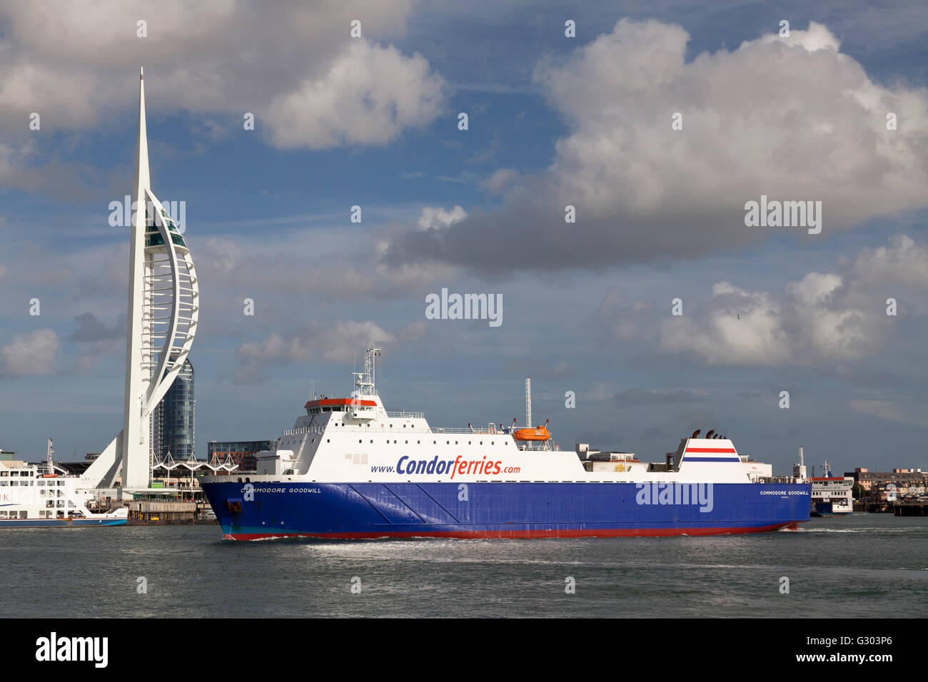 Condor Ferries 'Commodore Goodwill' entering Portsmouth Harbour past Spinnaker Tower, England, United Kingdom, - Stock Image