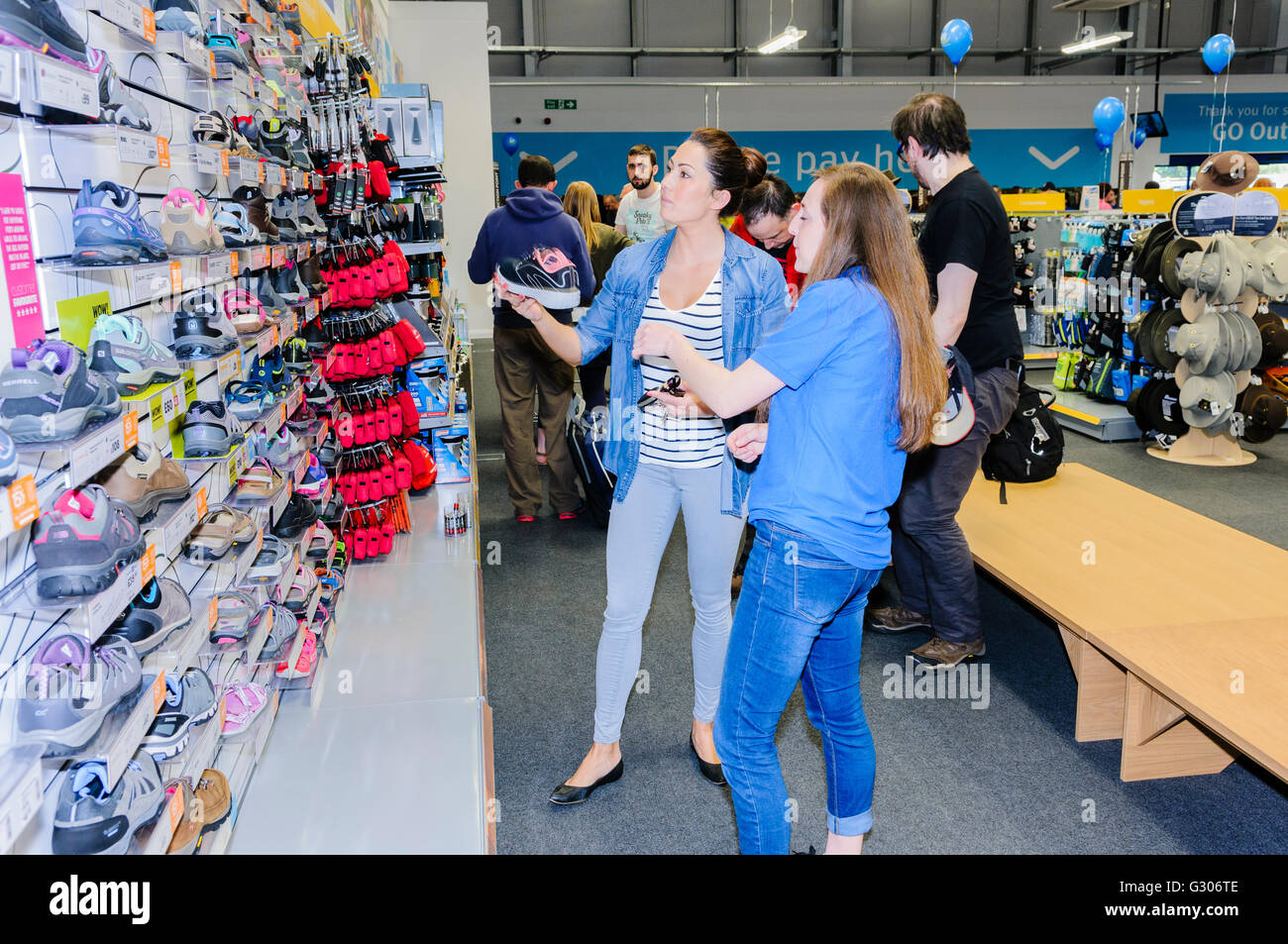Customers look at ladies' running shoes