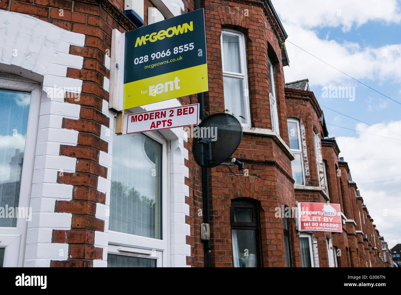 Estate agent signs advertising two-bedroom apartments, two story houses which have been converted into HMOs. - Stock Image