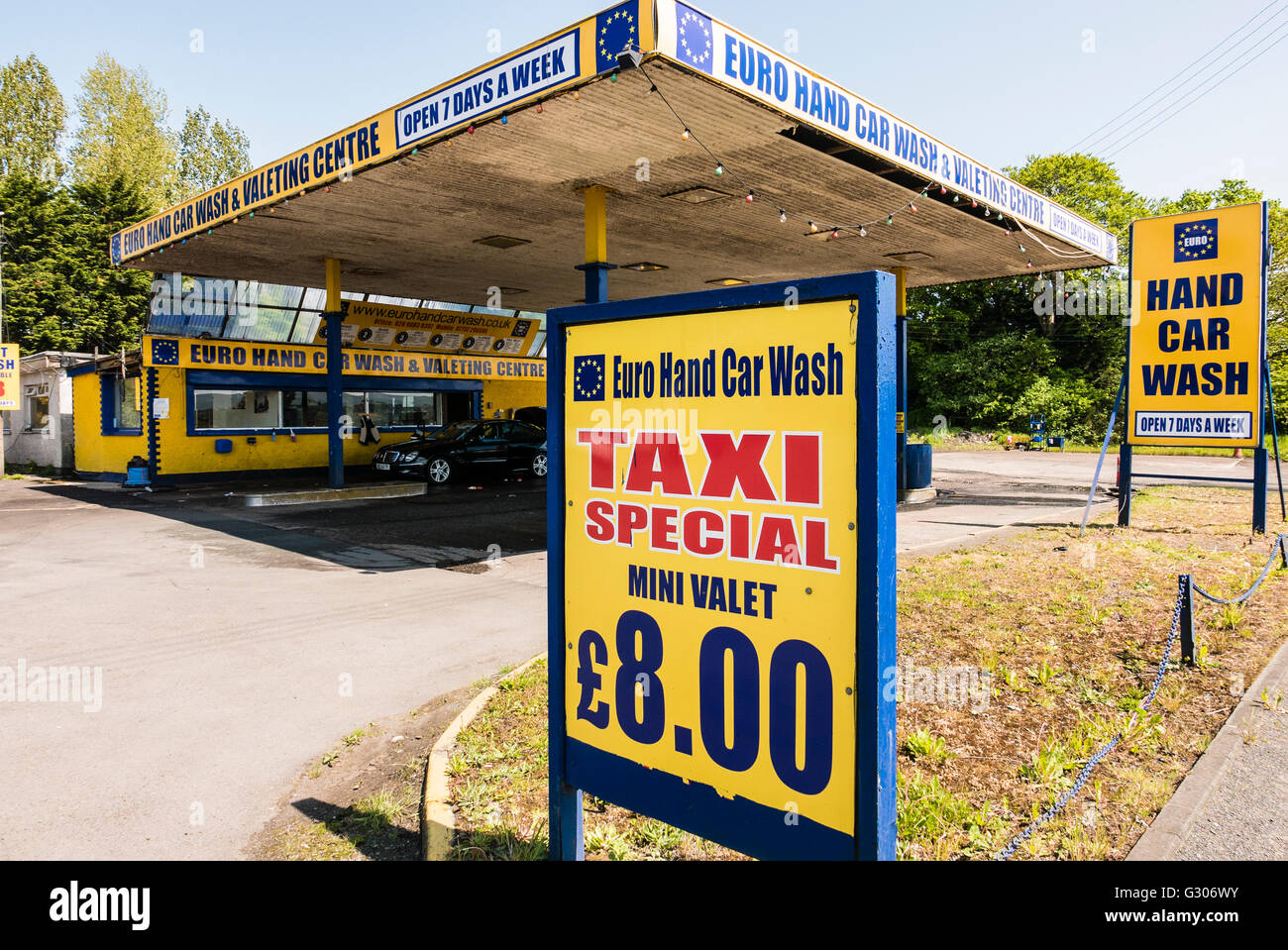 Car wash signs stock photos car wash signs stock images alamy signs at a euro hand car wash including one for a taxi special solutioingenieria Images