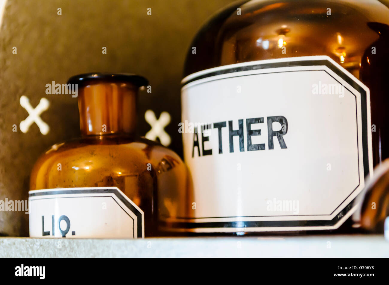 Bottles, including aether (ether) anaesthetic on shelves within a doctor's surgery from WW1. - Stock Image