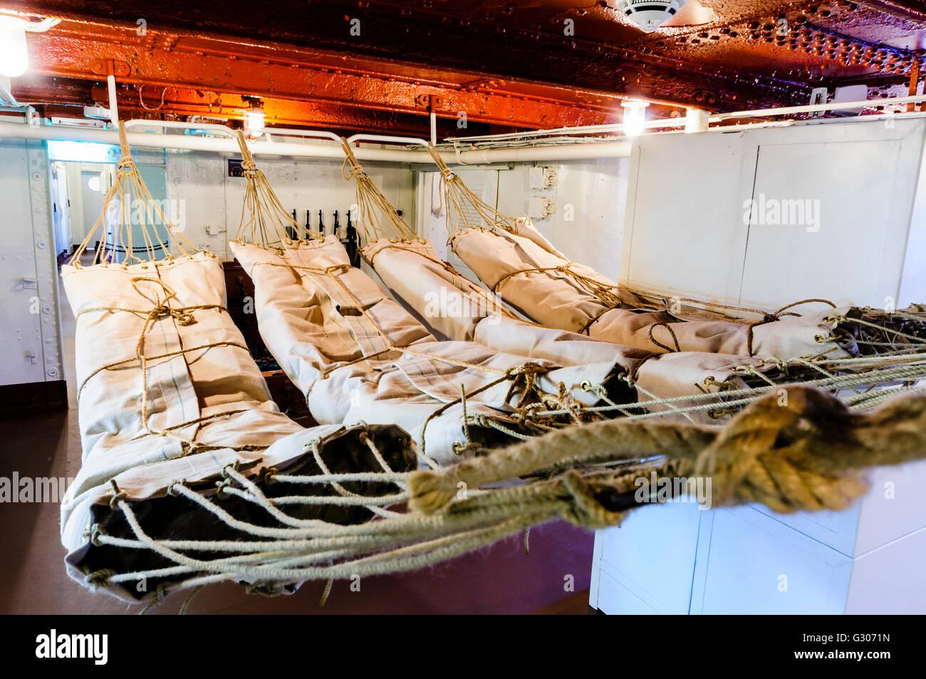 Crew member's hammocks on HMS Caroline, Belfast, the last surviving ship from the Battle of Jutland. - Stock Image