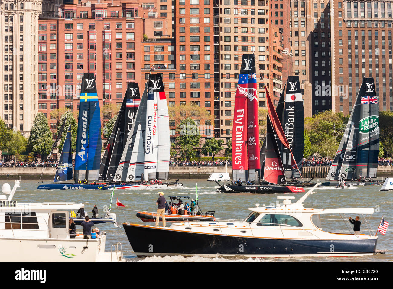 Louis Vuitton America's Cup World Series team catamarans race on the Hudson River course surrounded by spectator - Stock Image