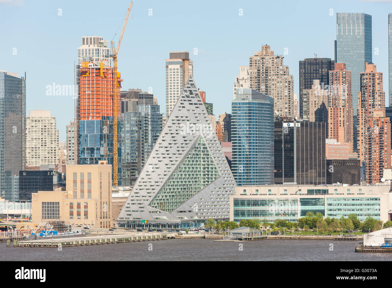 Part of the evolving mid-town skyline, including pyramidal VIA 57 West, on West 57th street, in New York City. - Stock Image