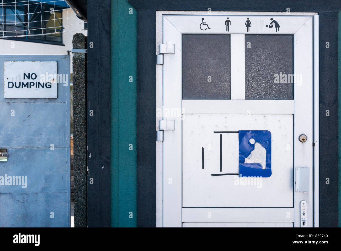 'No Dumping' sign beside a toilet. - Stock Image