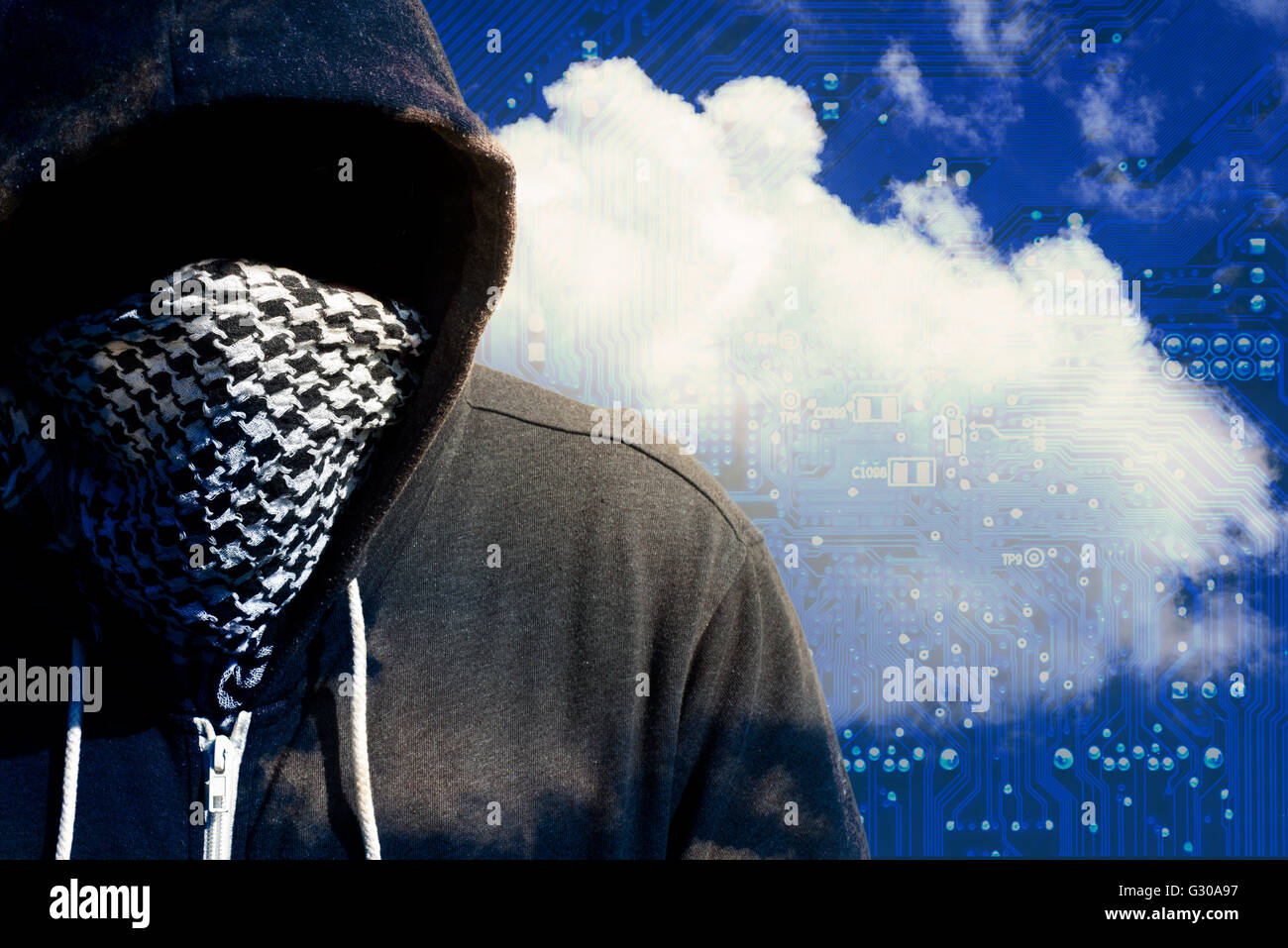 Hooded and masked computer hacker thief with a cloud computer based background and tech backdrop. Unknown technology - Stock Image