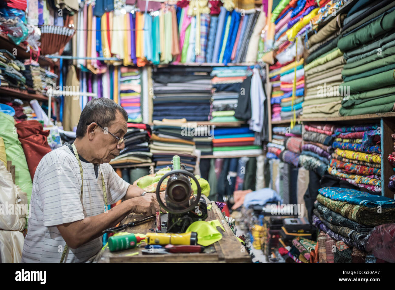 Man sewing in Sabang Market, Pulau Weh Island, Aceh Province, Sumatra, Indonesia, Southeast Asia, Asia - Stock Image