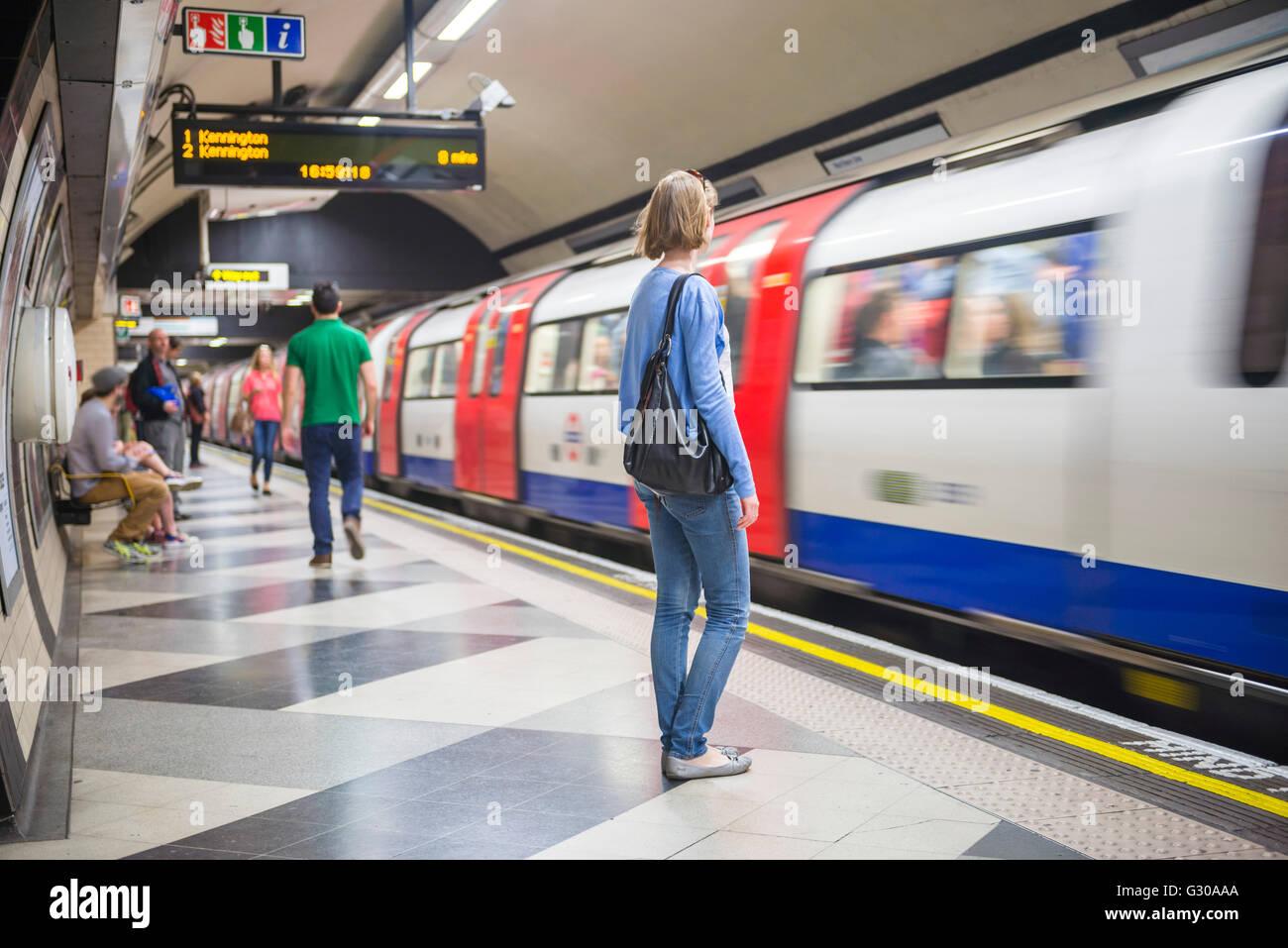 Person waiting at Waterloo underground station for the tube, London, England, United Kingdom, Europe - Stock Image