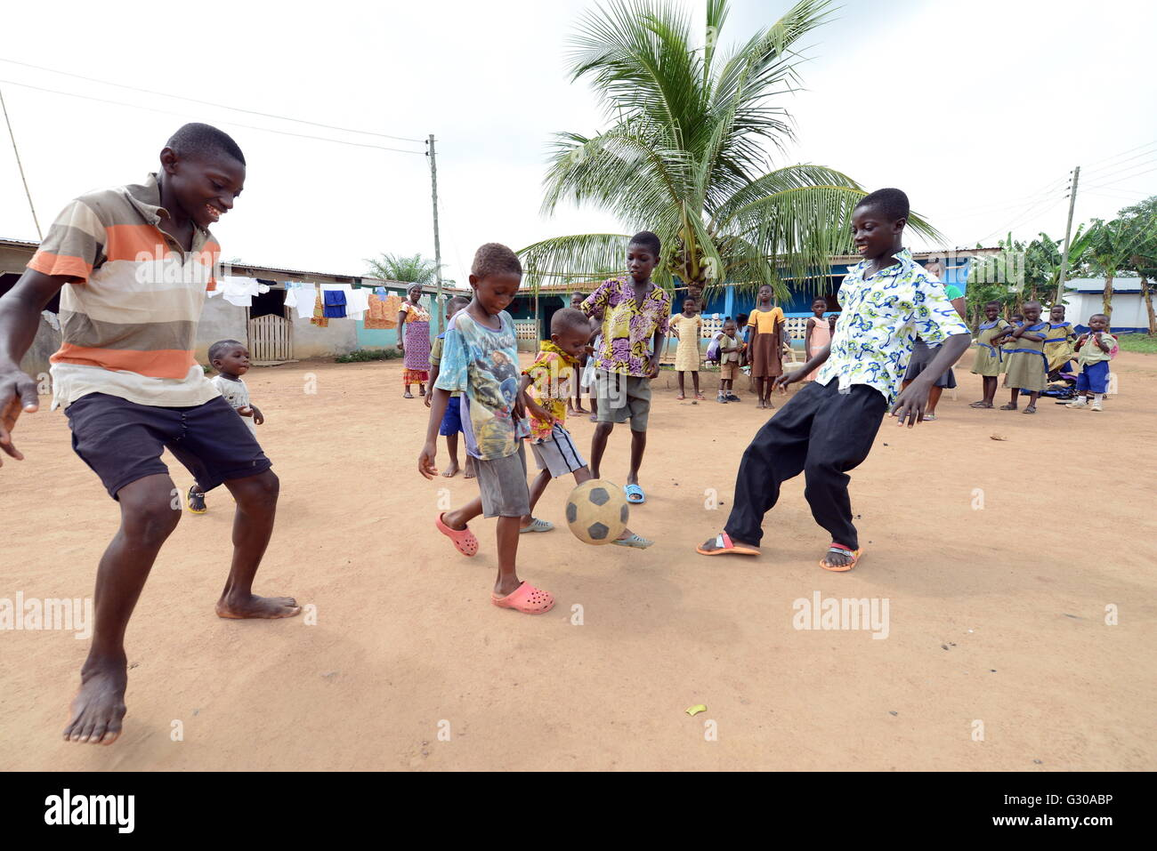 Boys playing football, Adiembra, Ghana, West Africa, Africa - Stock Image