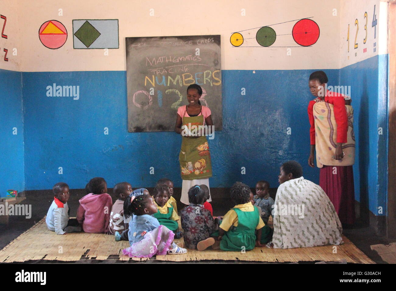 Small children and teacher, Malawi, Africa - Stock Image