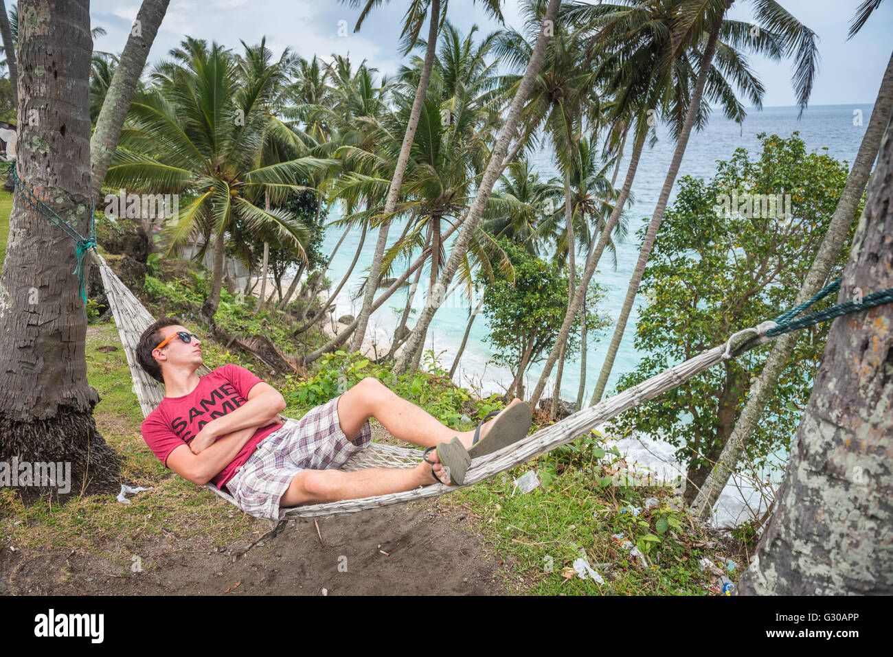 Tourist in a hammock at the beach, Pulau Weh Island, Aceh Province, Sumatra, Indonesia, Southeast Asia, Asia - Stock Image