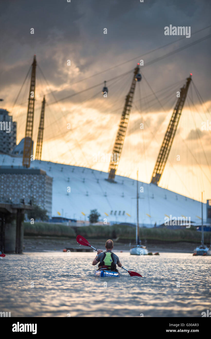 Kayaking on the River Thames at sunset by the O2 Arena, Greenwich, London, England, United Kingdom, Europe Stock Photo