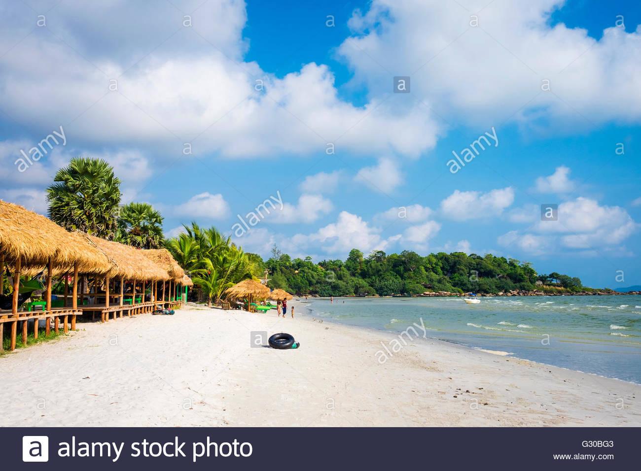 Thatched huts with hammocks along Ochheuteal Beach, Sihanoukville, Preah Sihanouk Province, Cambodia, Indochina, - Stock Image
