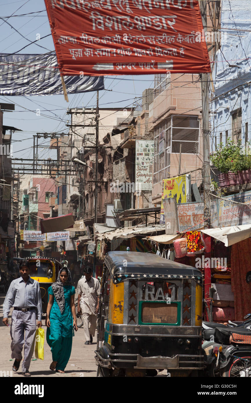 A narrow busy street in the city of Jodhpur, Rajasthan, India, Asia - Stock Image
