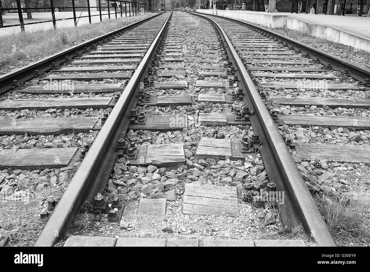 Railway tracks on an abandoned industrial site. - Stock Image