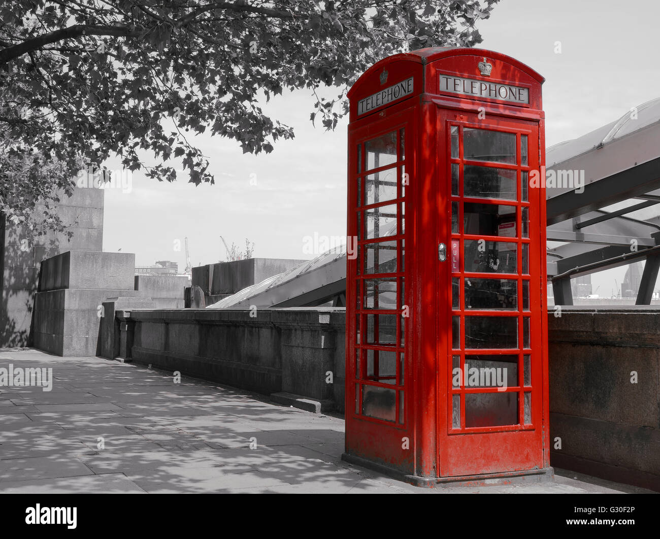 Red telephone box in street with historical architecture in London. - Stock Image