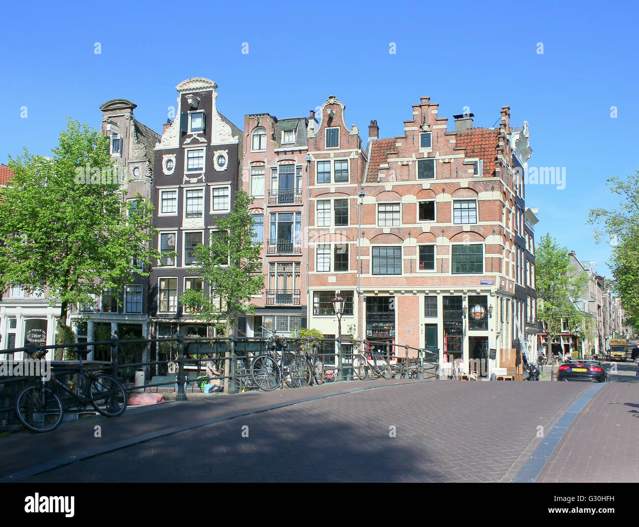 Historic stone bridge and 17th / 18th century houses where Prinsengracht meets Brouwersgracht canal in Amsterdam, - Stock Image