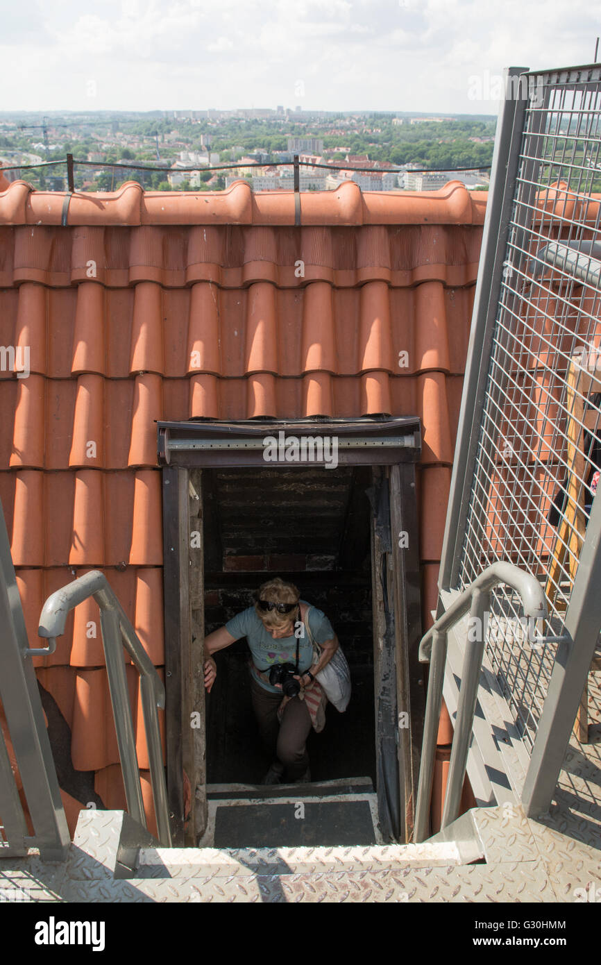 St Mary's Church, Gdansk, Poland - woman climbing up to the 78 metre high tower viewing platform  to enjoy views - Stock Image