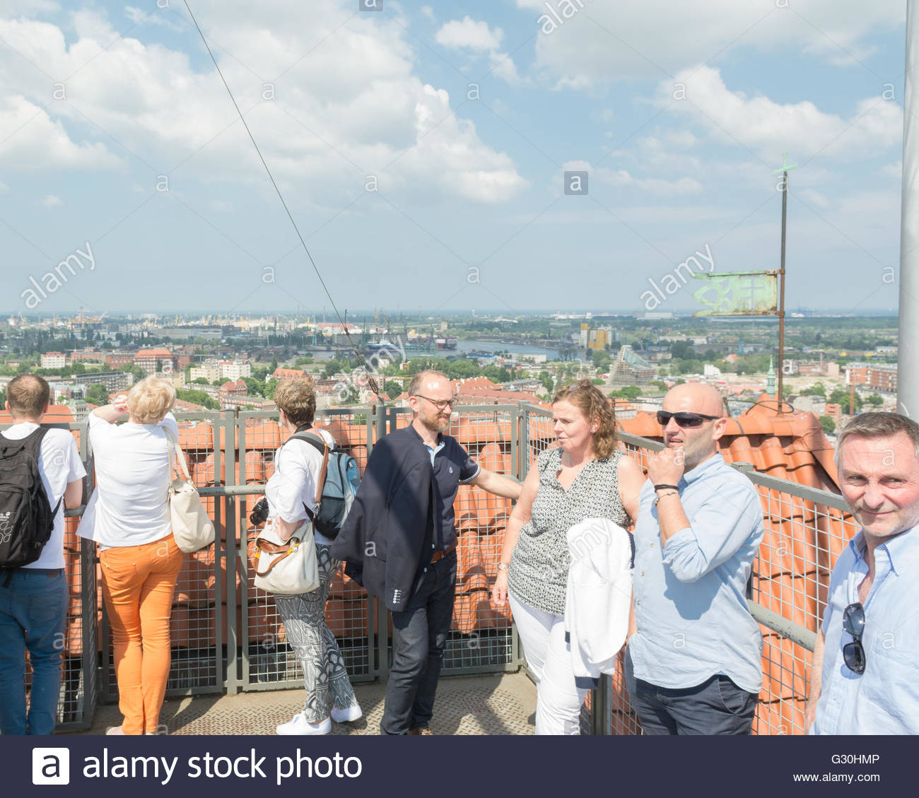 St Mary's Church, Gdansk, Poland - People tourists enjoying the views of Gdansk from the 78 metre high tower - Stock Image