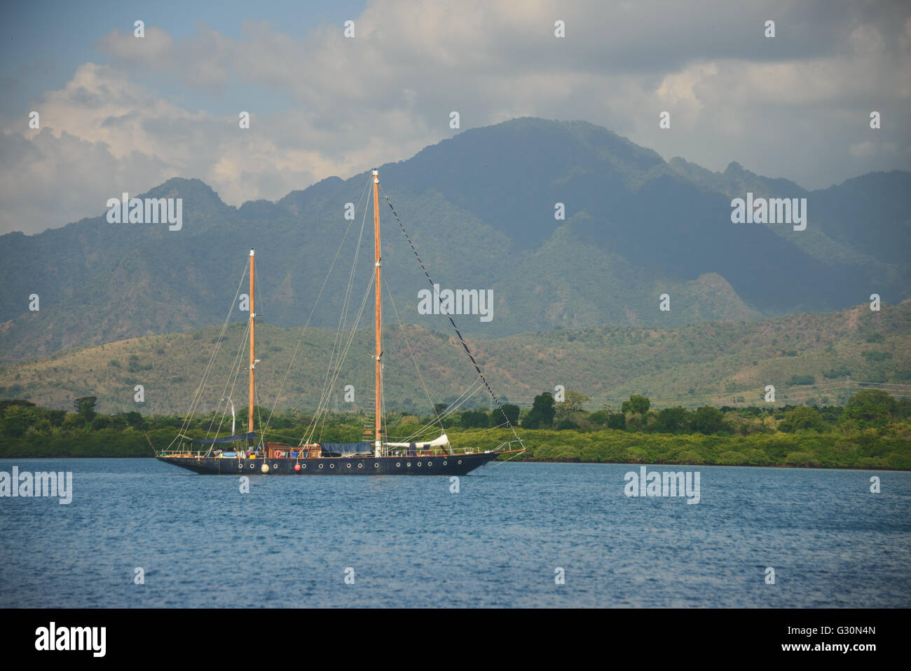 Yacht off the north coast of Bali, Indonesia - Stock Image