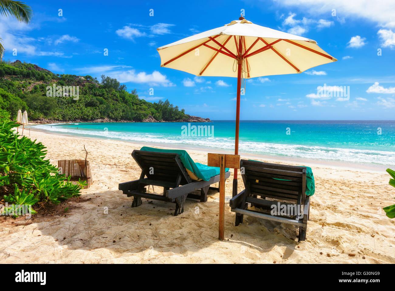Umbrella and sun loungers on the beach, Anse Intendance, Mahe, Seychelles, Africa, Indian Ocean Stock Photo