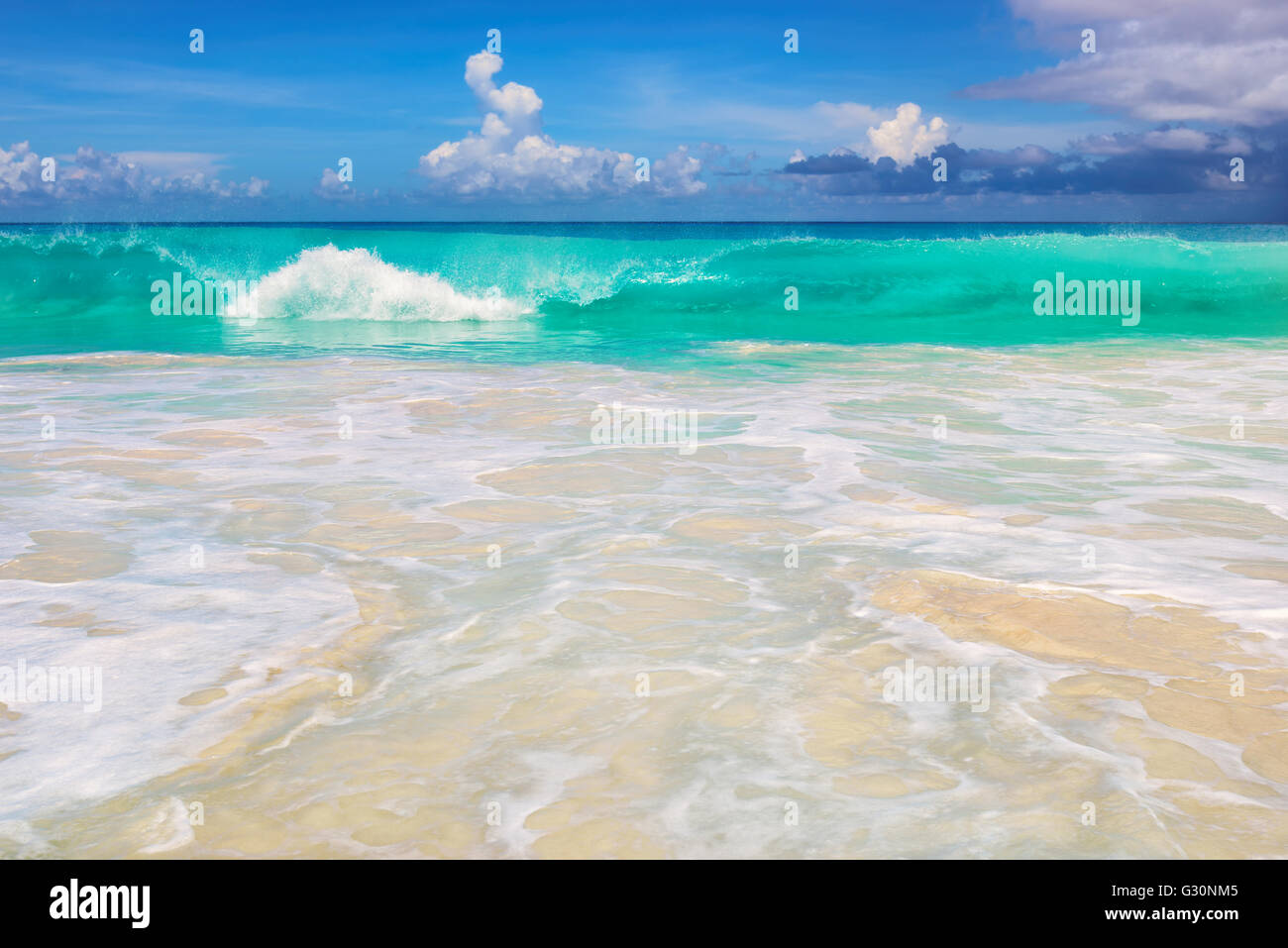 Beach, wave and clouds - Stock Image
