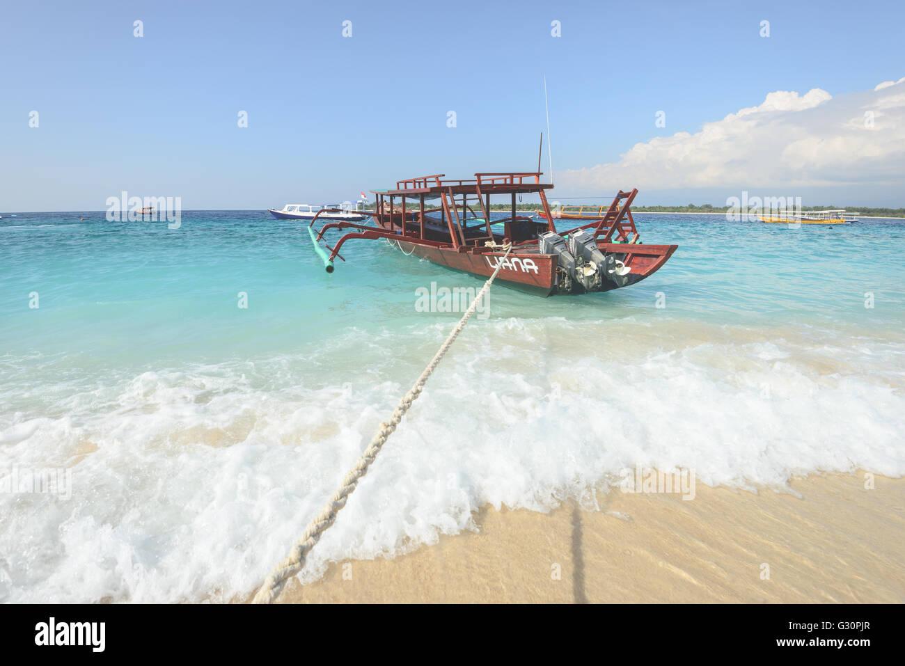 Boats anchored off Gili trawangan island in Indonesia - Stock Image
