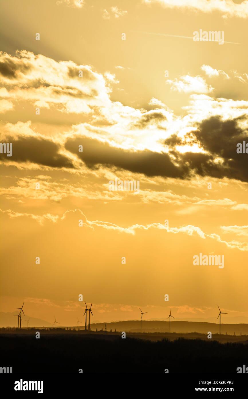 Windmills and sun concealed by clouds, Austria, Niederösterreich, Lower Austria, Donau, Petronell-Carnuntum - Stock Image