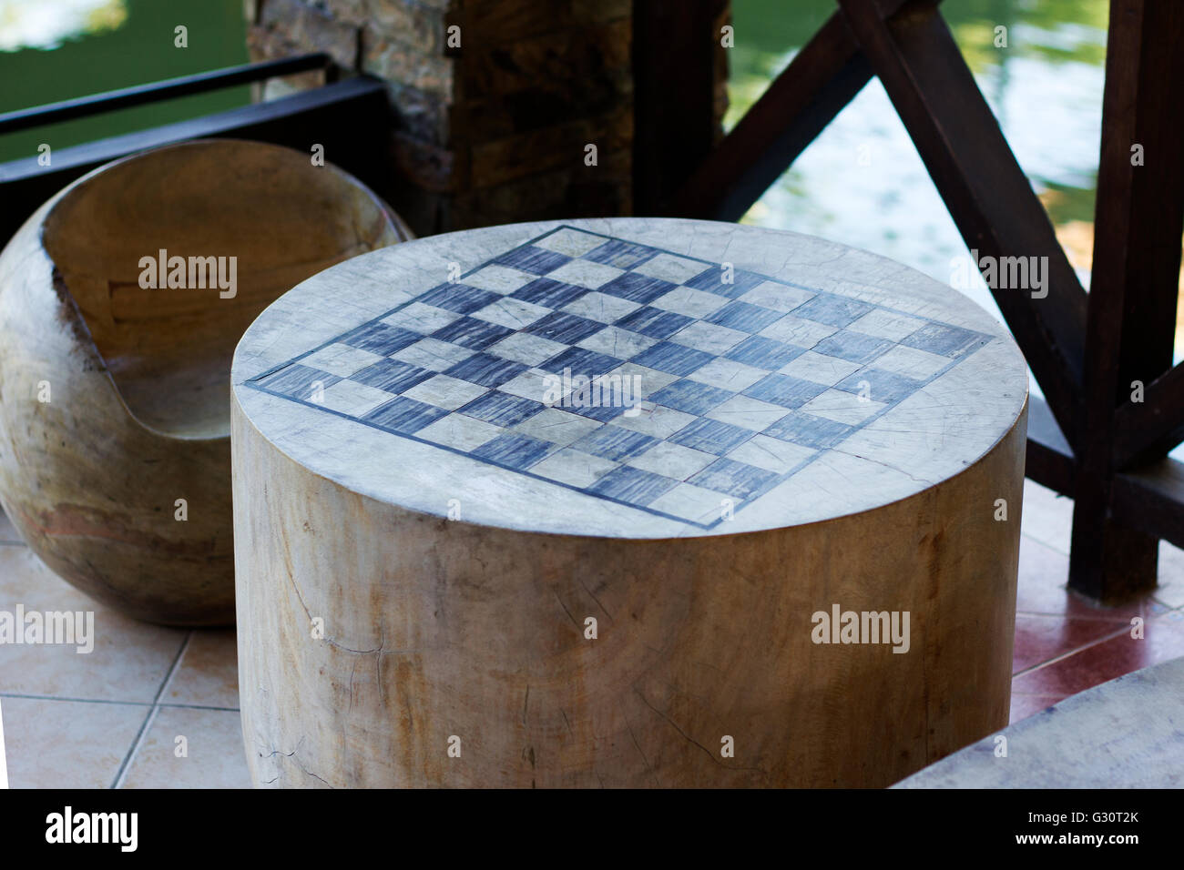 Chessboard drawn in wooden table - Stock Image