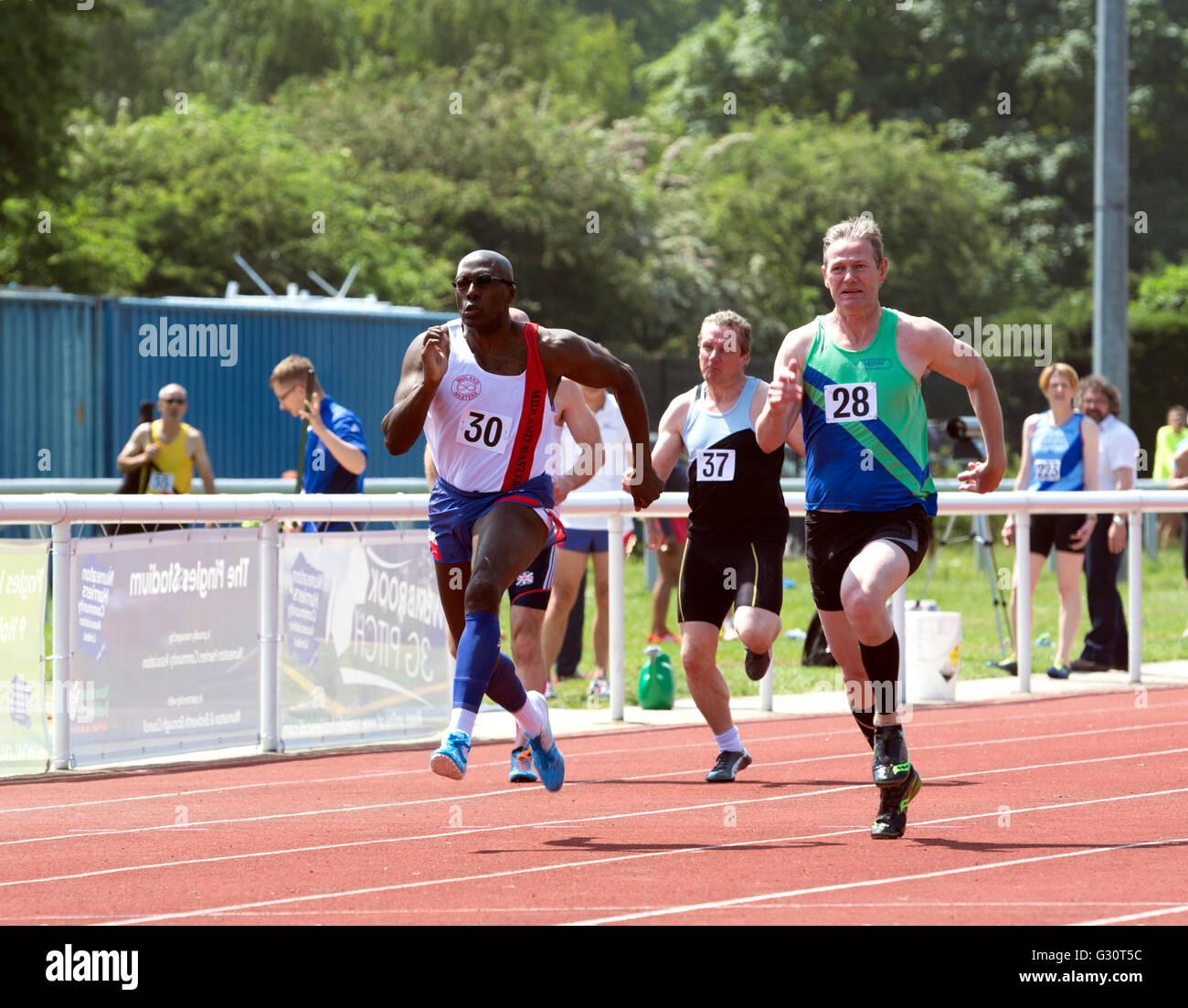 Masters athletics UK. Men`s 100m race. - Stock Image
